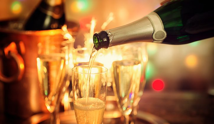 Pouring Champagne into Champagne Flutes